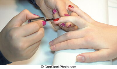 beautician applying Polish nails to women nails
