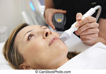 Beautician Carrying Out Ultrasound Skin Rejuvenation...
