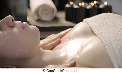 beautician does facial massage for beautiful woman in spa...