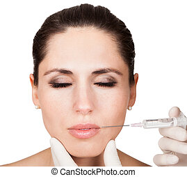 Beautician doing face injection to woman
