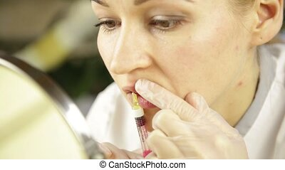 Beautician doing herself Lips injection with Hyaluronic Acid...