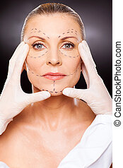 beautician doing skin check