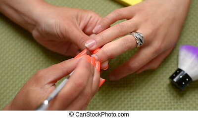 beautician make manicure