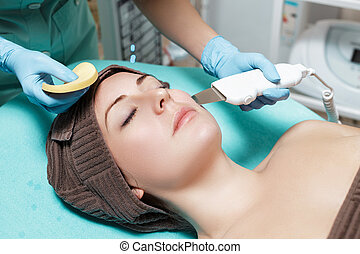 Beautician makes mechanical cleaning of face. cosmetology....