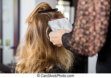 Beautician Putting Foils In Female Client's Hair