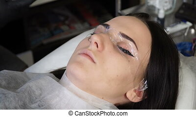 Beautician, specialist of permanent make-up the creation of...