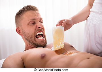 Beautician Waxing Man's Chest