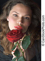 Beautifil lady with red rose. Romantic portrait