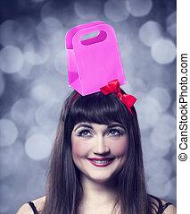 Beautifu brunette girl with present box.