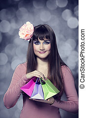Beautifu brunette girl with present boxes
