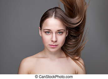 Beautifu brunette woman with long hair
