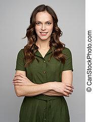 Beautiful 30 years old woman witn long wavy brown hair. Studio shot