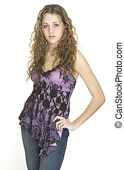 A pretty female model poses in jeans and a lacey purple top