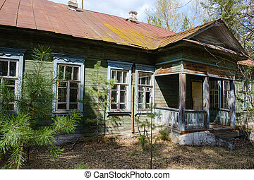 abandoned old wooden Russian house in the forest