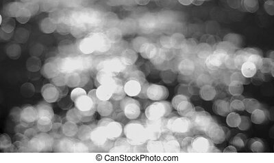 Beautiful abstract black and white glittering lights bokeh background. 3840x2160