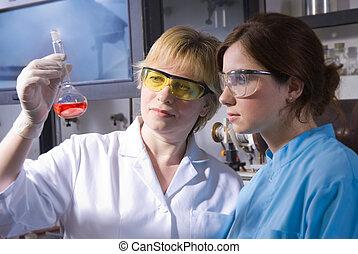laboratory work - Beautiful academic female team at ...