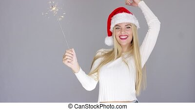 Beautiful adorable girl having fun with sparkler