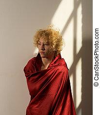 Beautiful adult blonde woman awakening.