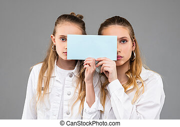 Appealing good-looking similar girls in white outfits ...