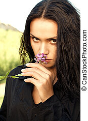Beautiful adult girl with wild flower