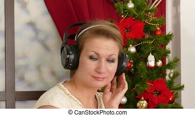 Beautiful adult woman listening to music