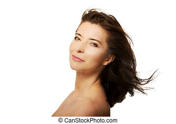 Beautiful adult woman with wind in hair.