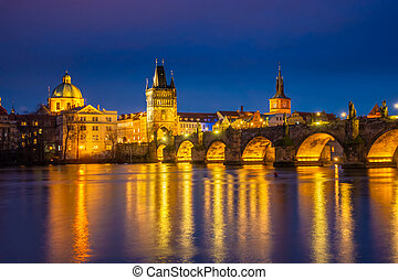beautiful aerial night view of Charles Bridge over Vltava river in Prague city, Czech Republic