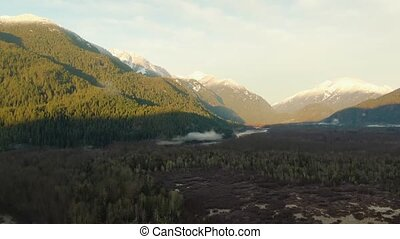Beautiful Aerial Panoramic View of Canadian Mountain Landscape during a Sunny Sunrise. Taken near Squamish, North of Vancouver, British Columbia, Canada. Nature Background Panorama