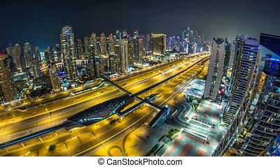 Beautiful aerial top view at night timelapse of Dubai Marina and JLT in Dubai, UAE