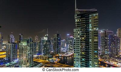 Beautiful aerial top view at night timelapse of Dubai Marina in Dubai, UAE