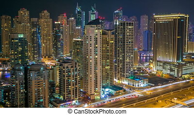 Beautiful aerial top view at night timelapse of Dubai Marina in Dubai, UAE