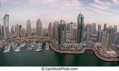 Beautiful aerial top view day to night timelapse of Dubai Marina in Dubai, UAE