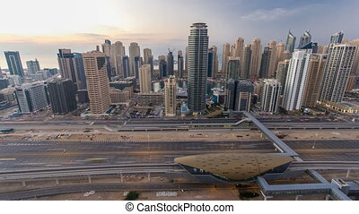 Beautiful aerial top view day to night timelapse of Dubai Marina and JLT in Dubai, UAE