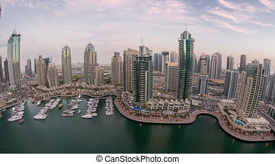Beautiful aerial top view day to night timelapse of Dubai Marina in Dubai, UAE