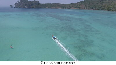 Beautiful aerial top view of long tail boat on turquoise sea...