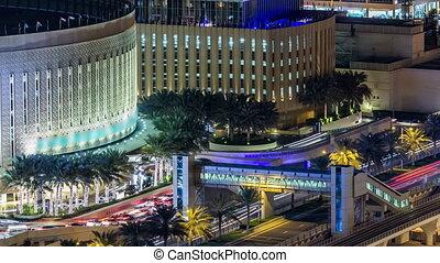 Beautiful aerial top view of traffic near mall at night timelapse in Dubai Marina in Dubai, UAE