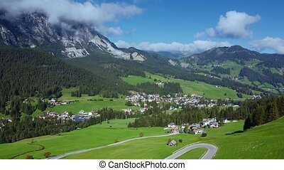 Beautiful aerial view of Badia village in Dolomites in Italy. Sunny weather and green surroundings.