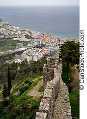 Beautiful aerial view of Sesimbra, Portugal - focus on defensive castle walls