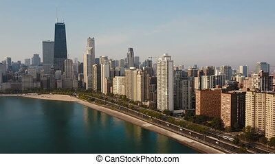 Beautiful aerial view of the Chicago, America in the morning. Drone flying away from the downtown, Michigan lake.