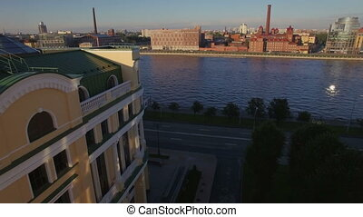 beautiful aerial view of the embankment of the river in a big city