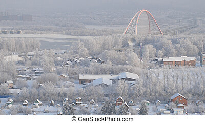 Beautiful aerial view of winter city with frozen bridge