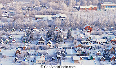 Beautiful aerial view of winter city with houses and trees