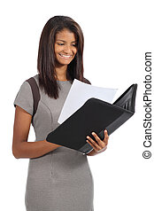 Beautiful african american businesswoman reading a report