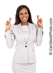 african american businesswoman with fingers crossed