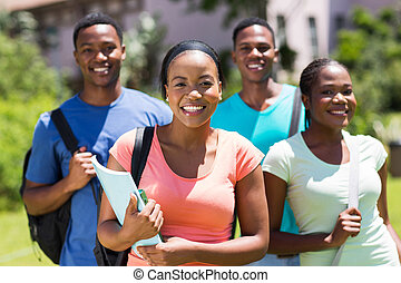 african american college girl standing in front of friends