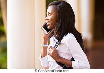 african american college student making a phone call