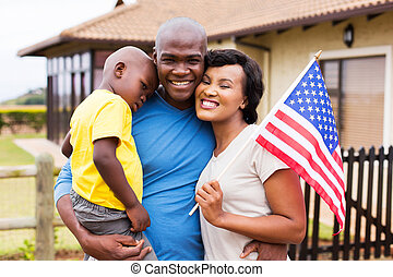african american family holding usa flag