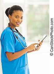 african american health care worker using tablet computer