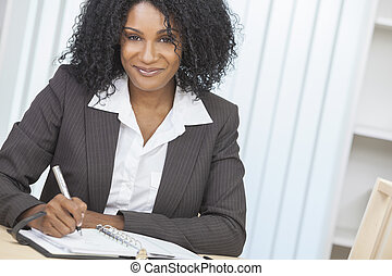 Beautiful African American Woman Businesswoman Writing