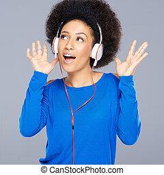Beautiful African American woman enjoying music